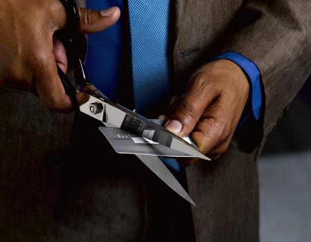 destructed: Business man credit card in half