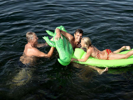 new age: Family playing in water