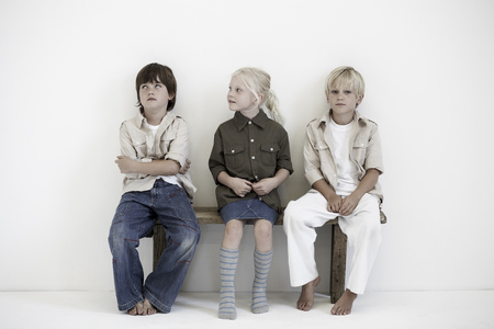 mischeif: Portrait of two boys and a girl on bench LANG_EVOIMAGES