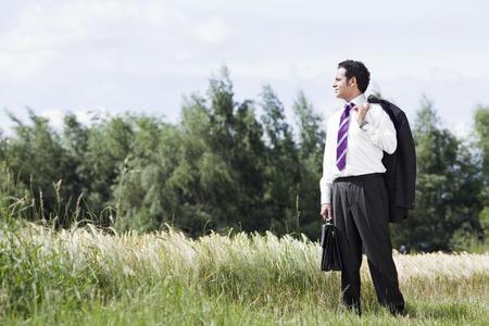 environmentalism: businessman in cornfield