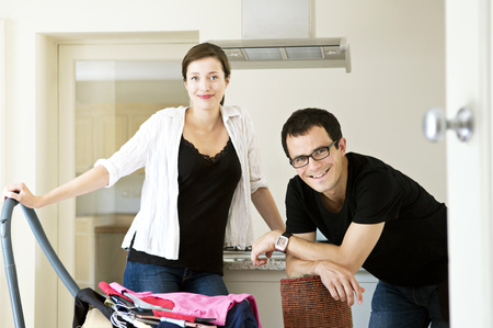 accomplishes: A young couple doing domestic chores