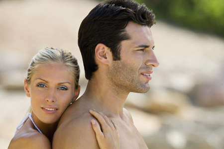passions: A couple embracing on the beach