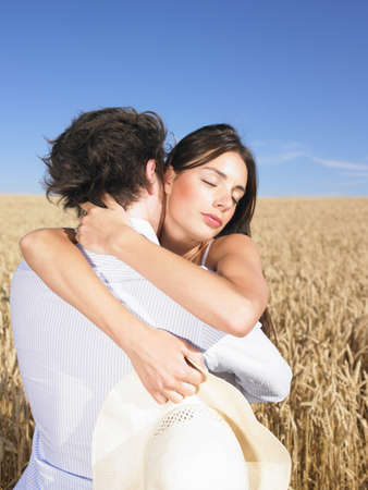 passions: young couple in wheat field