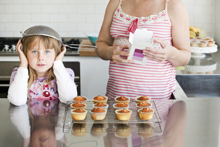 mischeif: Girl baking with sieve on her head