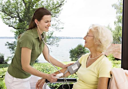 hinder: nurse taking womans blood pressure