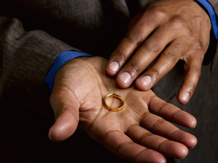 faithlessness: Business man showing wedding band