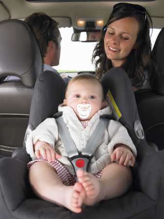 discretion: mother watching baby in car seat LANG_EVOIMAGES