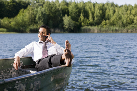 out of context: businessman on the phone in rowboat