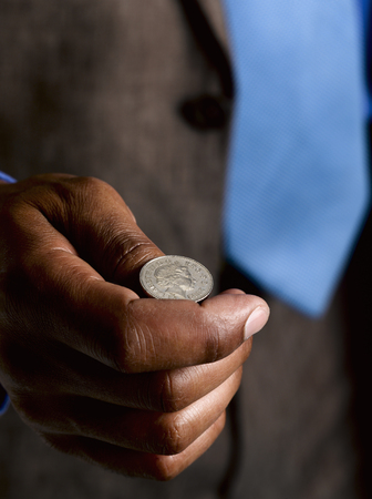 indecisive: Business man ready to flip sterling coin