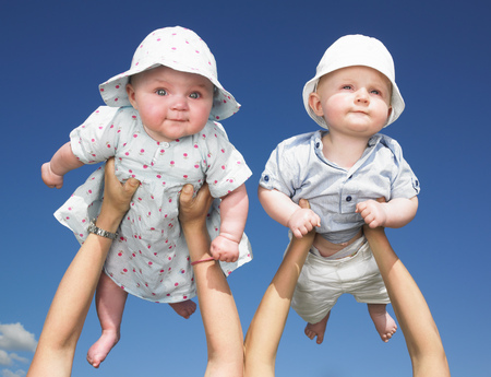 appendage: babies up in the air