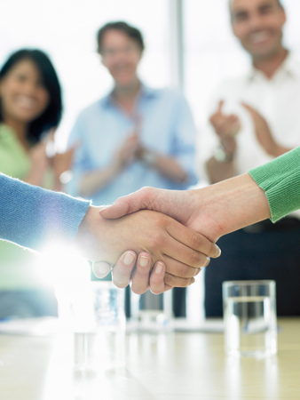 agrees: Closing a business deal by shaking hands