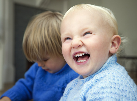 comically: A boy toddler laughing