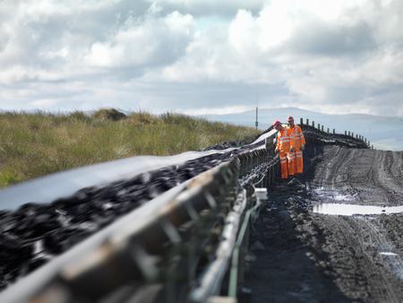 mined: Coal Workers Inspecting Conveyor Belt