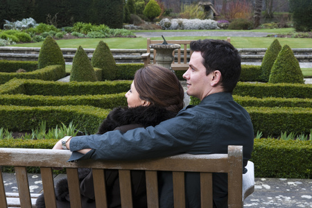 cherished: couple on bench in garden