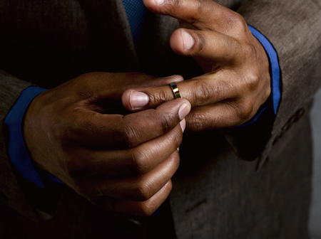 faithlessness: Business man putting on wedding band