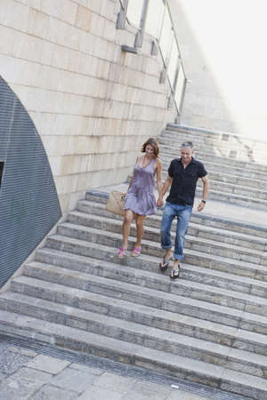 gratified: couple running down stairs