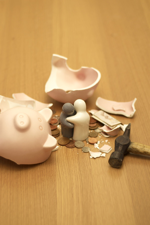 monies: small figures and smashed piggy bank