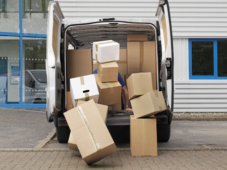 struggled: boxes falling from back of van