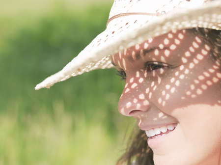 shadowed: Woman in sun hat in sunshine LANG_EVOIMAGES