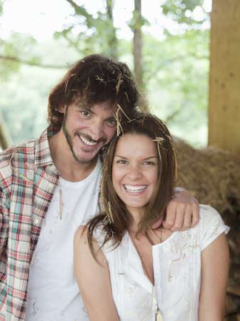 gratified: Man and woman in hay barn