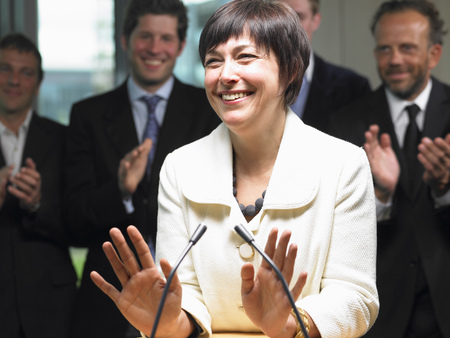 public servants: Business woman giving a conference LANG_EVOIMAGES