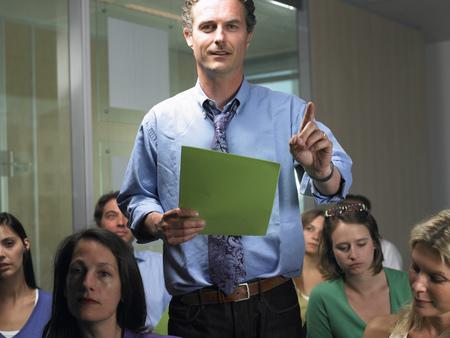 interrogations: Man standing, asking a question