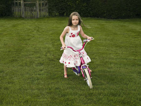 gratified: A young girl on a bike