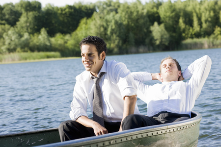 out of context: two businessmen relaxing in rowboat