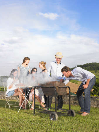 barbecues: young people having barbecue