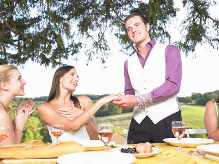 suggests: friends having dinner outside