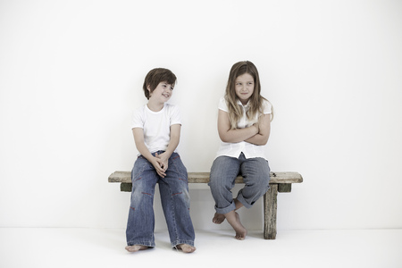 timidity: Young boy smiling at shy young girl