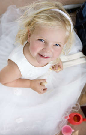 flowergirl: young girl in white dress portrait