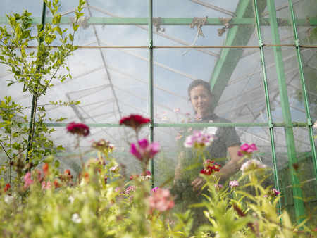 conservatories: Female Gardener In Greenhouse LANG_EVOIMAGES