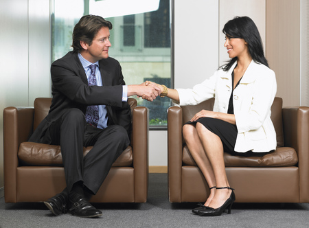 gratified: Business man and woman shaking hands