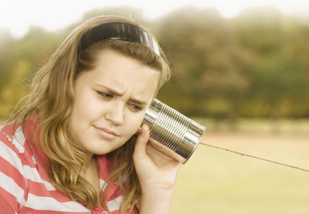 vintage: Girl Listening to Tin Can Phone