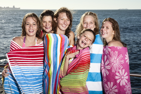 saturating: Girls wrapped in towels laughing
