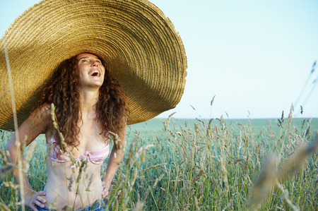 light blue lingerie: Woman with hat, in a wheat field