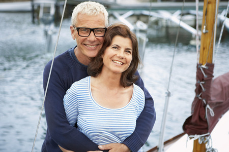 in twos: Middle aged couple on an old boat