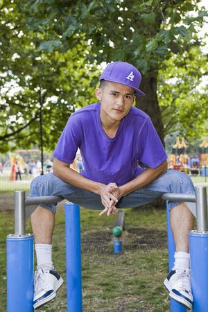 limber: Hispanic Teenager in a park LANG_EVOIMAGES