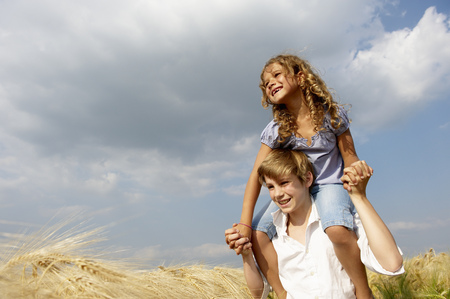 brotherly love: Brother and sister in a wheat field