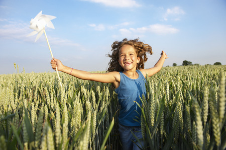 hearted: Girl with in a pinwheel in a field