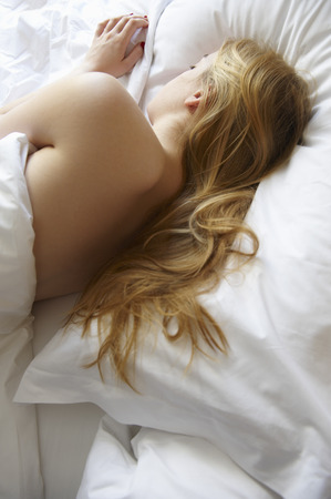 doze: Woman sleeping in bed