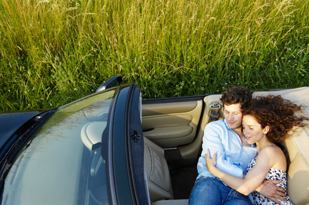 sweethearts: Couple laying in a convertible