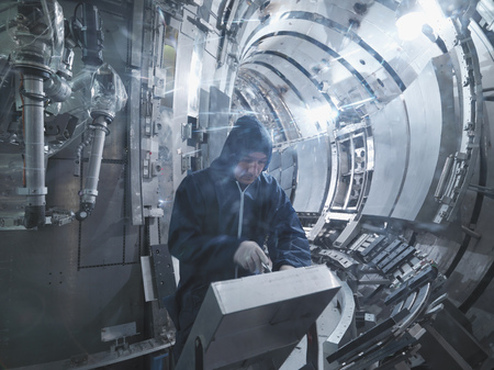 jeopardizing: Scientist Working In A Fusion Reactor LANG_EVOIMAGES