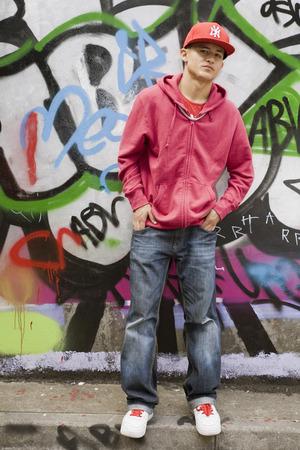singularity: Hispanic Teenager against graffiti wall LANG_EVOIMAGES