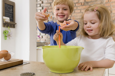 new age: girl and boy mixing ingredients