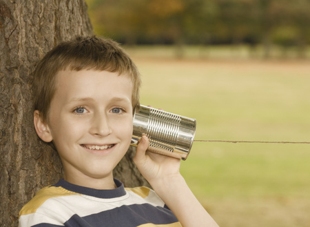outmoded: Boy Listening to Tin Can Phone