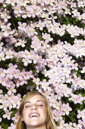 lays down: Woman laying down in the flowers