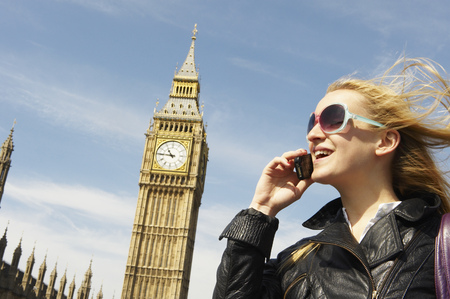 sightseers: Woman on the phone, next to big ben LANG_EVOIMAGES