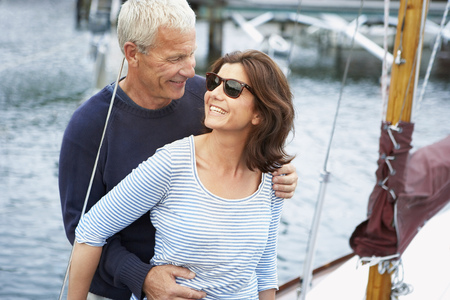 cherished: Middle aged couple on an old boat